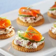 """All the flavors of a classic"""" New York City lox and schmear bagel"""" ~Cream cheese, capers, cucumber and lox in one single, delicious bite. Finger Food Appetizers, Yummy Appetizers, Appetizer Recipes, Snack Recipes, Cooking Recipes, Cream Cheese Snacks, Smoked Salmon Appetizer, Cocktail Party Food, Kitchens"""