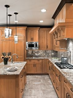 Looking for pics of mid-tone cabinets with light countertops. This is too busy with the backsplash.