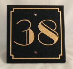 """This would look great above the garage door or on the letterbox! Art Deco Sign; Type Five  The Carved house sign here has been made in black granite. The sign dimensions shown are 15cmm x 15cmm (6""""x6"""") and comes with choice of numbers.  Order no.: AD105  Our price: £ 23.00 + £5 P     http://www.charlieroe.com/art-deco/art-deco-misc/art-deco-house-signs/art-deco-house-signs.html"""