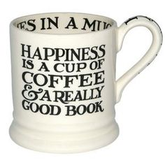 Happiness is a cup of coffee & a really good book. :)