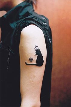 #cat #tattoo on the arm with crown