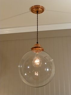 Copper Pendant Light with a 12 inch Clear Glass Globe. $128.00, via Etsy.