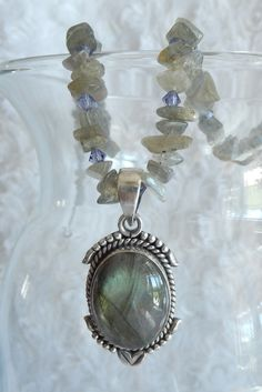 """This necklace has a Labradorite Pendant set in an oxidized 925 Sterling Silver.  It has Labradorite chips and Swarovski Crystals for added """"bling"""".  It measures approximately 19 inches long.  The pendant is 1 3/4 inches long and 3/4 inch wide.    Original price was $37.00  Some Believe that....."""