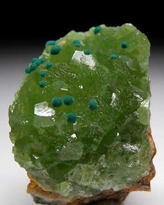 Malachite on Cuprian Smithsonite Tsumeb, Namibia  Small spheres of Malachite attached to the surface of cuprian Smithsonite crystals.