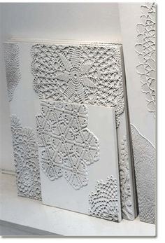 lace doilies on canvas and painted white