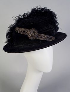 Black velvet hat with beaded ornament and ostrich feathers, ca. 1915, KSUM 1996.58.24.