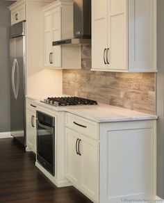 A wood look FLOORING TILE installed in a #kitchen #backsplash. This ...
