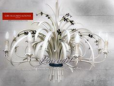 Lavender chandelier with 8 lights Spike lavender chandelier in aged tempera. White with natural colour flowers. Country collection by GBS, lavender flowers line. Wrought iron decorated by hand. MADE IN ITALY.