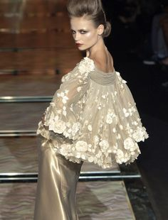 Valentino haute couture      The caplet and makeup have it.