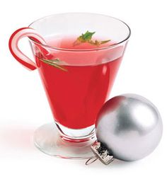 Peppermint Cosmo: 1 cup pomegranate juice  Juice of 1 lime  4 oz vodka  1/4 teaspoon peppermint extract  8 ice cubes  8 mini candy canes  2 tablespoons chopped fresh mint