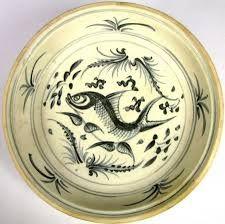 Vietnamese, Tran dynasty, 14th century, Vietnam. Stoneware with green glaze, underglaze iron - Buscar con Google