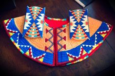 front of beaded cape with beaded hairties by Norma Flying Horse
