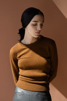 Hermès - Vestiaire d'Hiver 2013. Pullover in tobacco camel hair, trousers in satin-finish graphite lambskin, neck chain in pink gold. #hermes #fashion