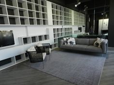 Libreria LEMA mod. Selecta, divano, poltroncine e tappeto LIVING Divani.