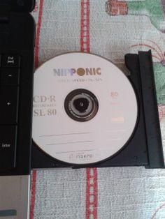 365/134 - Arrumando algumas fotos e colocando em cd único jeito de eu não perder.