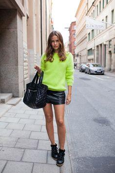 Caroline killing it in neon + black leather in Stockholm. Wearing: knit - Acne, shorts - Maje, boots - IM, and bag - Chanel (natch) #CarolineBlomst #StockholmStreetstyle #CarolinesMode