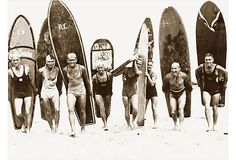 1930, this group of surfers in Sydney, Australia are more than ready for a lively surf's up