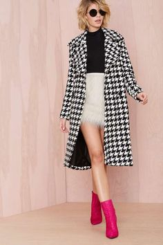 black and white with a bold pop of pink