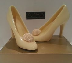 Perfect gift for the bride, bridesmaids or Mother of the Groom! White Chocolate shoes with edible pearl encrusted toe décor.  #Weddingshoes  www.azrachocolates.co.uk
