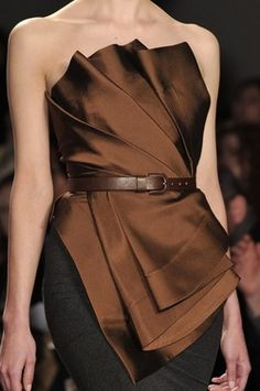 Donna Karan. Love it...but it's crying out for a stunning belt instead of the plain brown one.