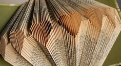 Rhymes With Magic: free patterns Amazing site with book folding tutorials. Folded Book Art, Paper Book, Paper Art, Paper Crafts, Cut Paper, Old Book Crafts, Book Page Crafts, Altered Books, Altered Art