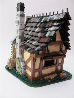 Medieval potion shoppe by thelet. Incredible roof - both the shape and the pieces used