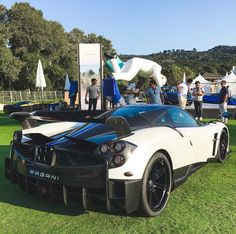 Pagani Huayra BC painted in White w/ exposed carbon fiber and White and Blue central stripes  Photo taken by: @keystothejungle on Instagram   Owned by: @dan_am_i on Instagram