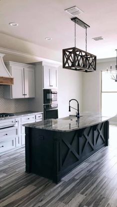 I love the contrast between the counters and the cabinets that are different colors