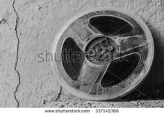 Film canister crack wall - stock photo
