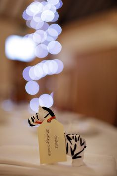 Cute idea for wedding favours - mini fimo polymer clay animals for the kids, so cute! This was a safari themed wedding, love this photo.