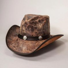 The Limited Edition Faultline leather cowboy hat is as classically western as it gets. They are high-quality, top-grain cowhide, and finished so they show the texture and subtleties of the cowhide while maintaining visible pull-up, which means that the hats get more characterized as you handle them. Complemented by a matching buffalo nickel band, these hats are great additions to any cowboys' or cowgirls' wardrobe.  #hats #cowboyhats #cowgirlhats Leather Cowboy Hats, Cowgirl Hats, Western Hats, Cowgirls, Cowboys, Fossil, Buffalo, Handle, Community