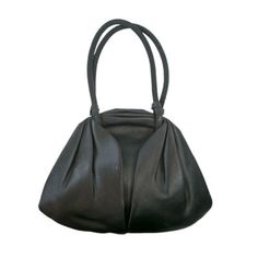Elegant French Black Satin & Bakelite Purse   From a collection of rare vintage handbags and purses at http://www.1stdibs.com/fashion/accessories/handbags-purses/