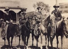 Cowboys.  Christoval, Texas late 1800's Women riding side saddle with Colt 45 peacemaker