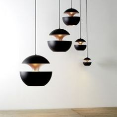 Here comes the sun, doo doo doo doo. This Pendant by DCW éditions Paris looks as if it is lit by the sun itself. The light comes from within the 2 layers, casting a copper glow similar to that of an actual sunrise. The Satin Aluminum exterior is a beautiful contrast to the Copper interior. A black cord keeps things clean.