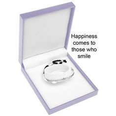 """Equilibrium Silver Plated Half Bracelet - SMILE.A beautiful silver plated half bangle with a special message inscribed on it  """"Happiness comes to those who wait""""  This is a unique design with a fantastic look to it. Half silver plated bangle, and half black thread - amazing  The equilibrium jewellery makes a very special personal gift with a sentimental message ... a gift with meaning  The bangle comes in a beautiful padded gift box, and has a a slightly twisted design, so that the…"""