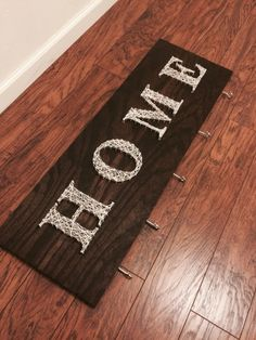 "DIY nail string art ""HOME"" key holder"