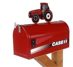 """Case IH Rural Style Mailbox with Topper Tractor Red by Distel Grain. $99.99. Case IH rural style mailbox features a large, sturdy steel mailbox with a baked on powder-coat finish.  Includes MX series tractor topper.  Rural style mailbox measures approx.  21""""LX8""""WX10.5""""H (plus tractor topper).  This mailbox meets US Postal Service specifications and can easily be installed on any post."""