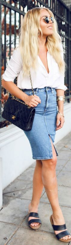 Angelica Blick wears the classic slit detailed denim mini skirt with a simplistic white plunge blouse and a Chanel cross body bag - a look ideal for work or play! Skirt/Sandals: Asos, Shirt: Lindex, Bag: Chanel.