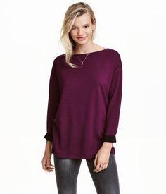 Burgundy. Long-sleeved top in soft, viscose-blend jersey. Boat neck, dropped shoulders, and short slits at sides.