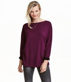 Burgundy. Long-sleeved top in soft, viscose-blend jersey. Boat neck, dropped shoulders, and short slits at sides.