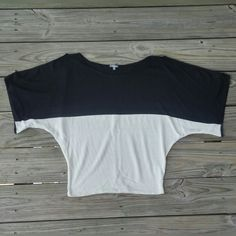 Black & White Light Sweater Cute black and white sweater with billowy 3/4 Length sleeves featuring keyhole cut outs along the shoulder/upper arm. Like new. Classy with a little bit of sexy. Charlotte Russe Tops Blouses