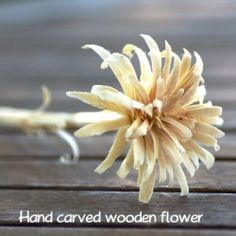 Watch a video showing how to carve a flower out of a stick of wood.