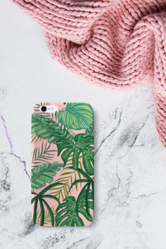 Arguably one of the most popular design trends currently, leaf and palm prints offer more than just another decor style. They allow us to live in a tranquil, tropical oasis. But these designs can make also a phone case very special! This stunning phone case is available for iPhone and Samsung. #phonecases #phonecovers #iphonecase #iphonecover #tropicalplants Tropical Plants, Phone Covers, Oasis, Decor Styles, Design Trends, Palm, Iphone Cases, Samsung, Popular