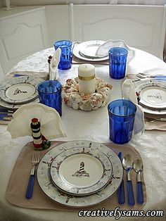 Lighthouse tablescape.Shell Centerpiece