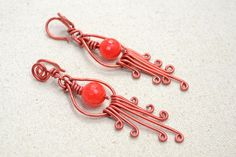This project aims at tutoring you some wire wrapping way to make a pair of Chinese style red chandelier earrings with aluminum wire and jade beads.