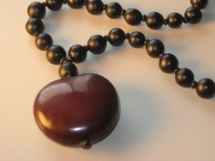 Sea heart bean necklace.  Sanding sea beans is fun :)