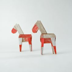 large wooden horse made from wooden roadblocks