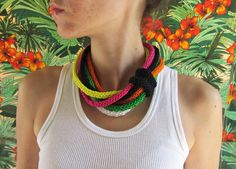 Multi-colored hand knitted necklace.. Want to try to spool knit one of these.