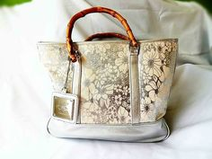 Available @ TrendTrunk.com White Silver Floral Tote Bamboo Handles. By Airoldi Couture. Only $36.00!