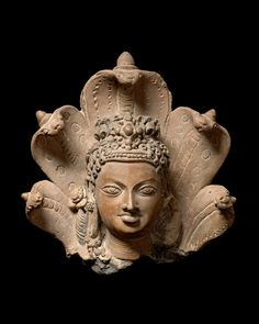 Head of Manasa, Hindu folk goddess of snakes, Gupta period, early 6th century  Terracotta. Also known as Vishahara (the destroyer of poison), she is the sister of Vasuki, king of Nagas (snakes).